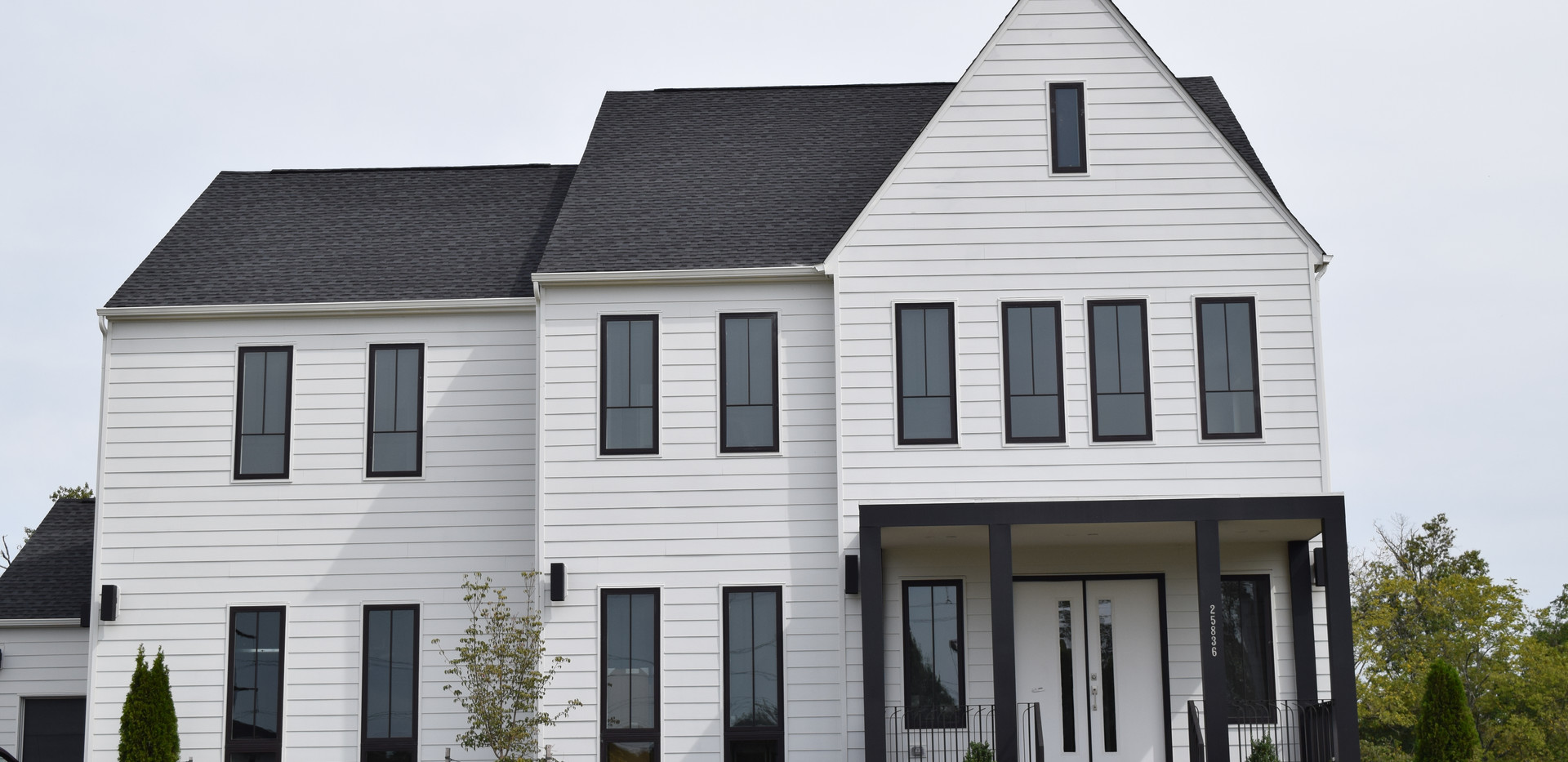 Modern Home with White Siding and Black