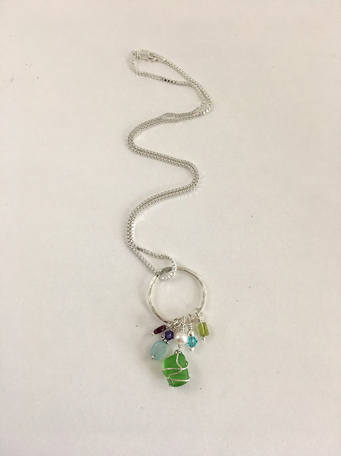 Handmade sterling silver and green sea glass pendant with freshwater pearls, gemstones and Swarovski beads