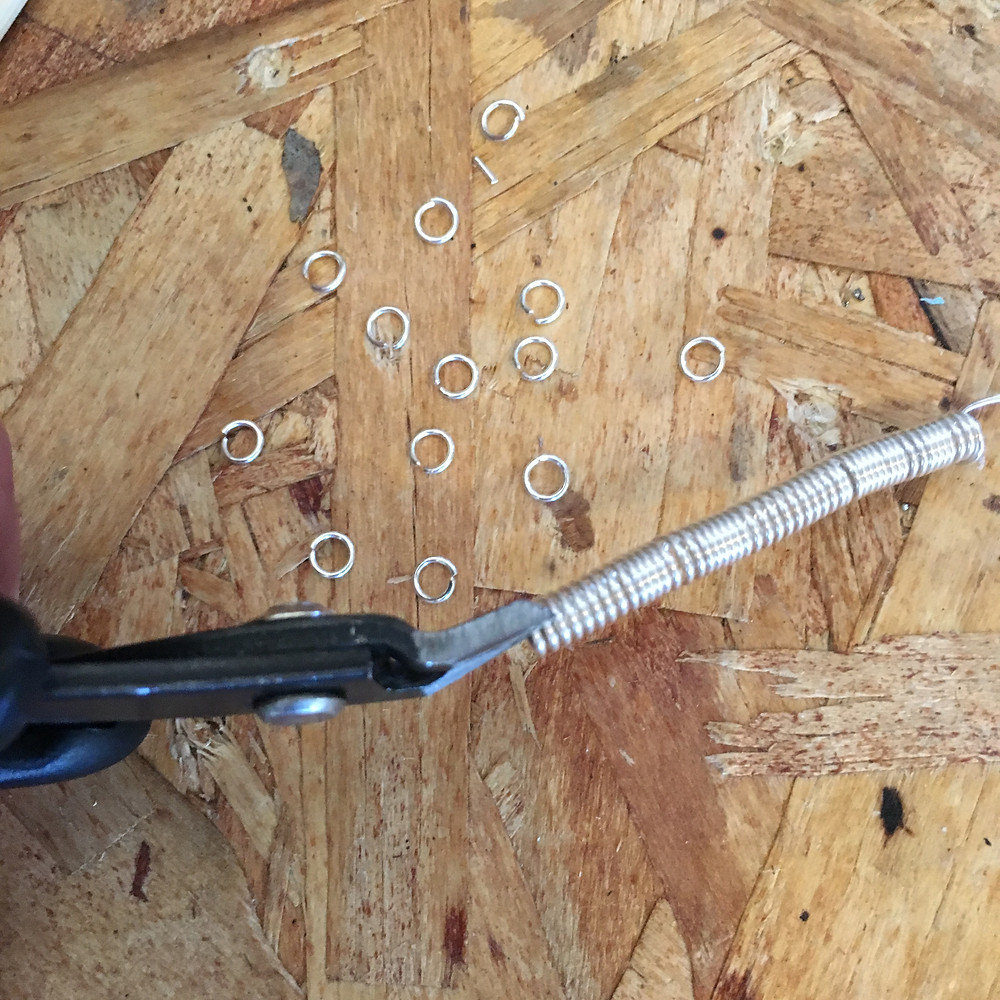 cutting the jump rings with flush cutters