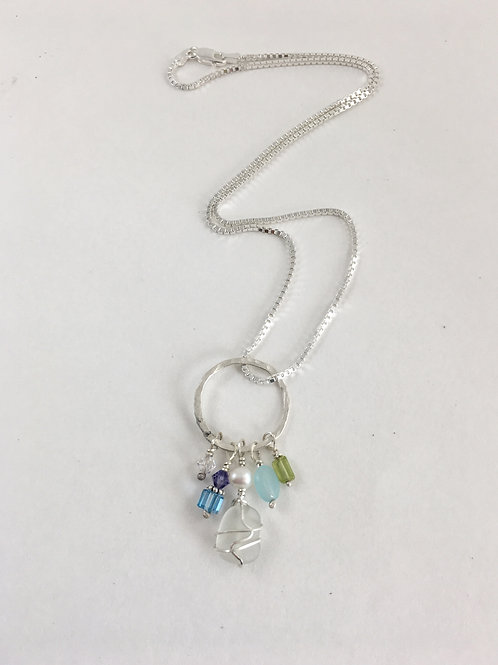 Handmade sterling silver pendant with white sea glass, peals and gemstones.