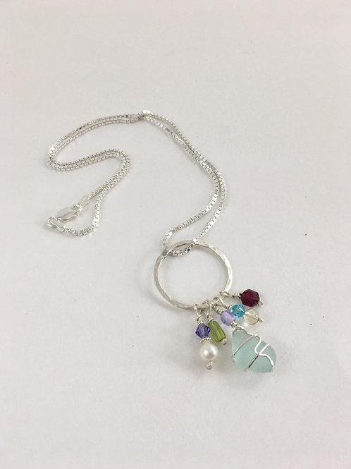 Light aqua sea glass and hand made sterling silver pendant with freshwater pearls, gemstones and Swarorvski beads