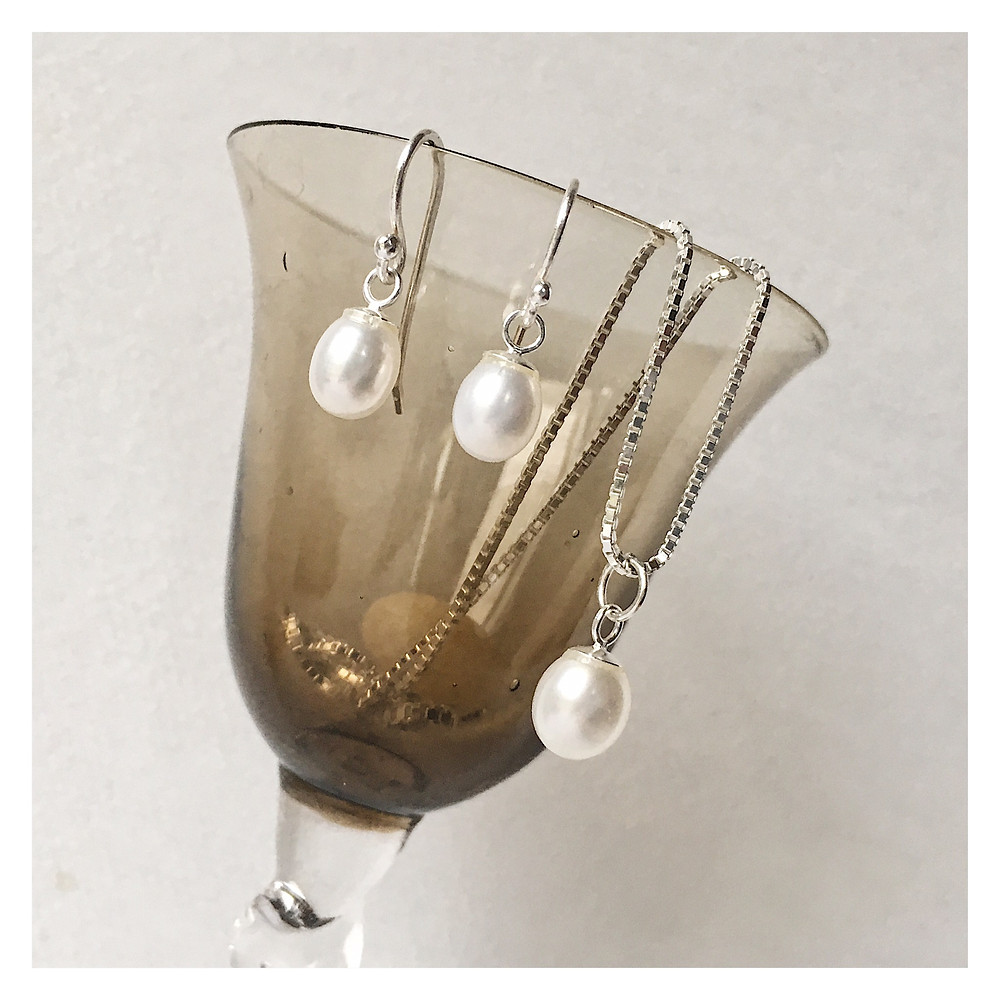 pearl drop earrings and pearl pendant