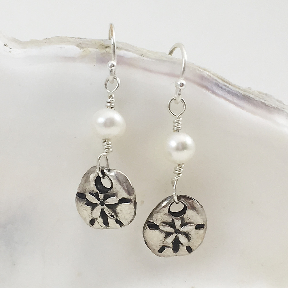 silver sand dollar and pearl earrings