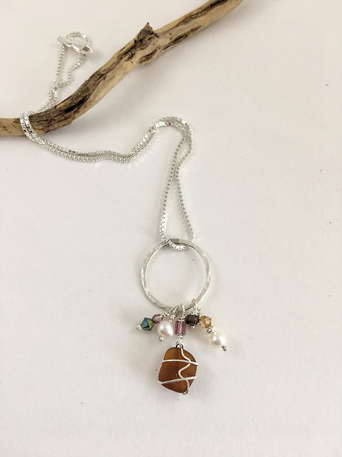 Handmade sterling silver and brown sea glass pendant with freshwater pearls and Swarovski beads