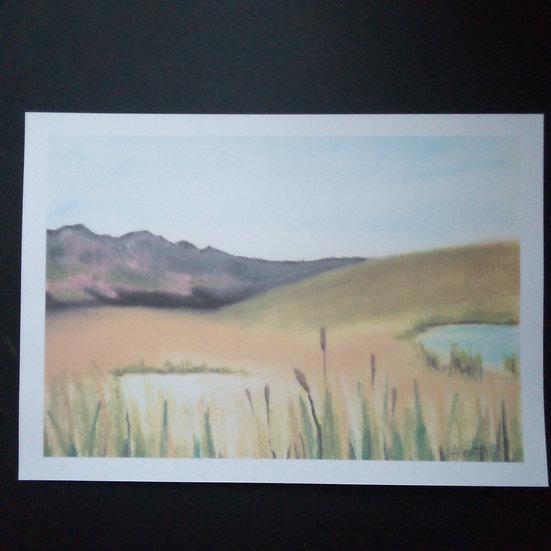 Water reeds under mountain