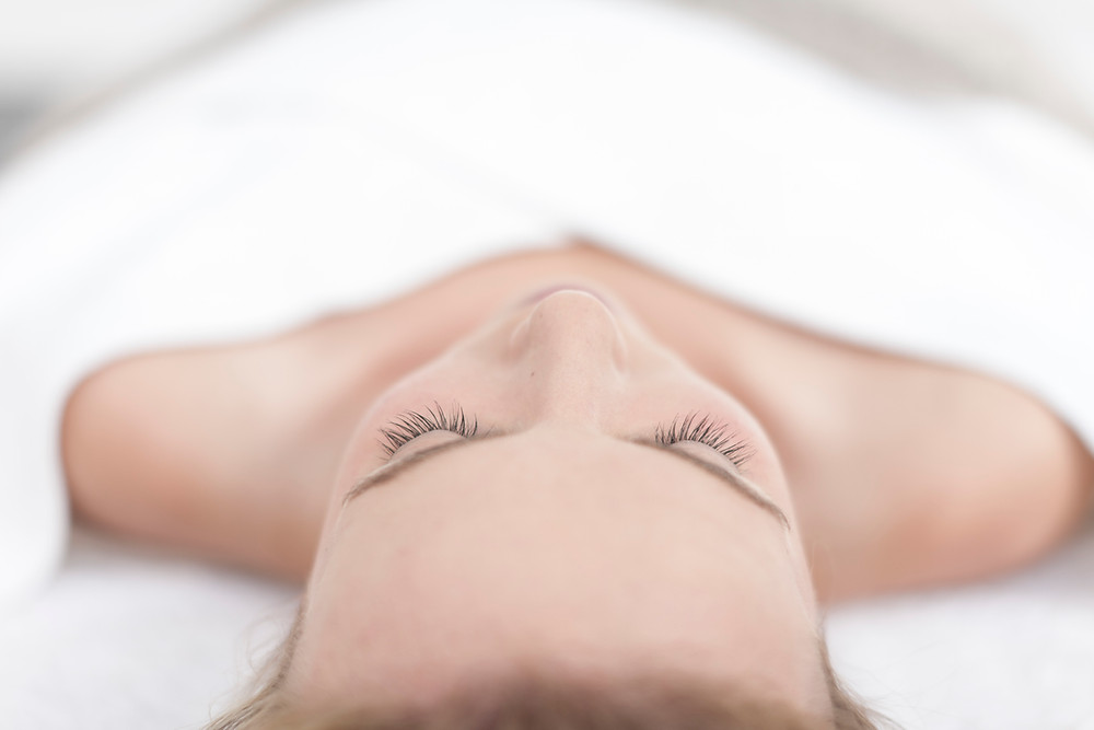 lash extension appointment woman laying