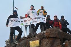 Volunteer team summiting Mt Kenya