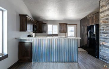 Custom Stained Cabinets & Reclaimed Wood Wall