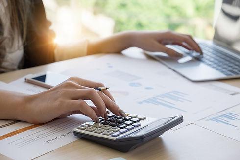 Close up Business woman using calculator