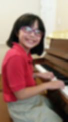 Piano student with confident smile