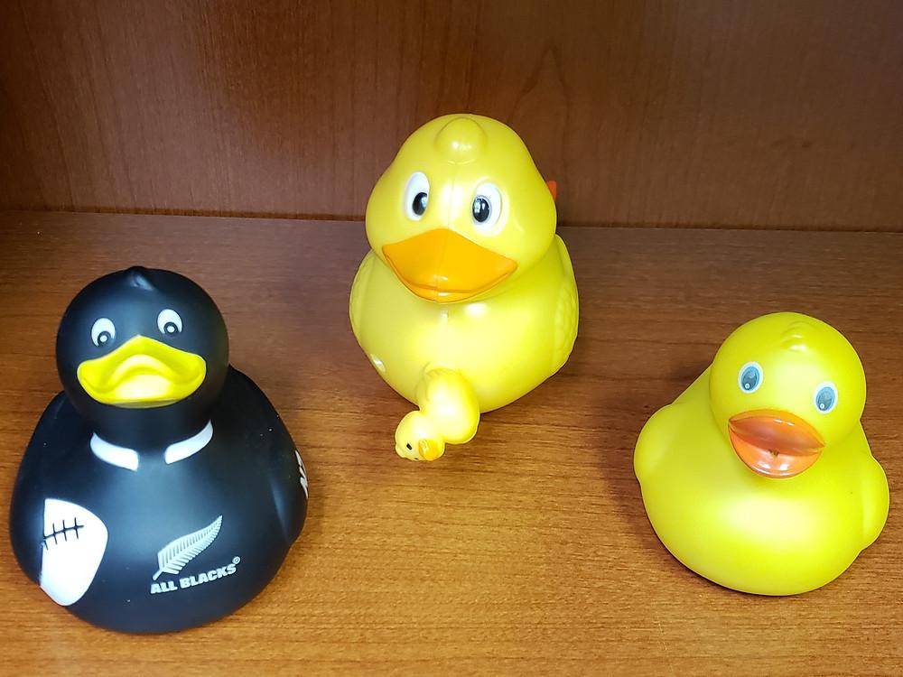 Three rubber duckies on Derek's desk