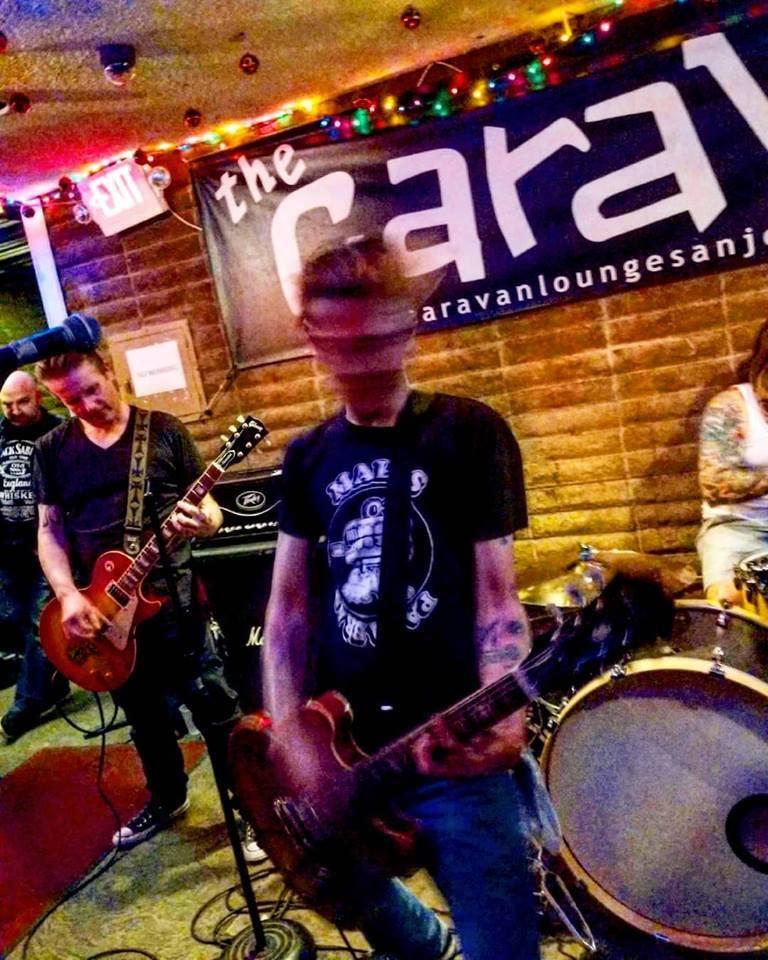 Johnny Shitbird playing bass