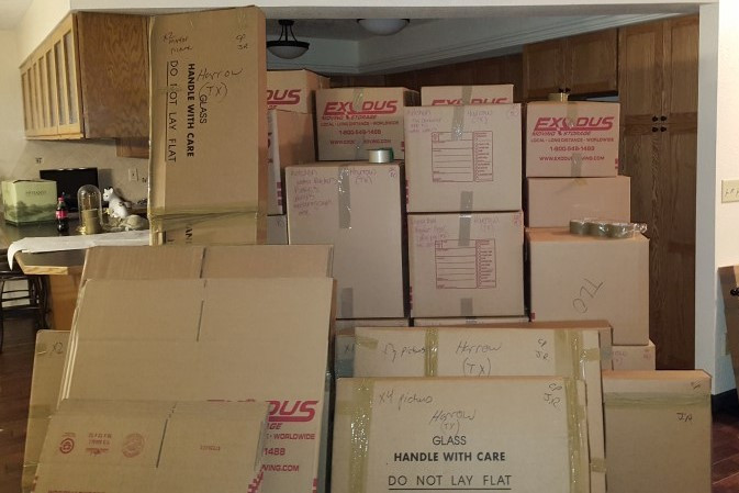 Large stack of moving boxes