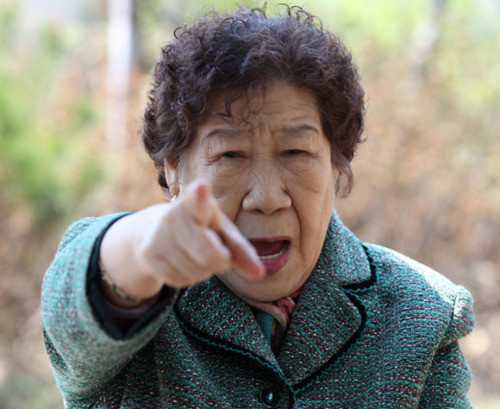 Korean woman angrily pointing at the camera