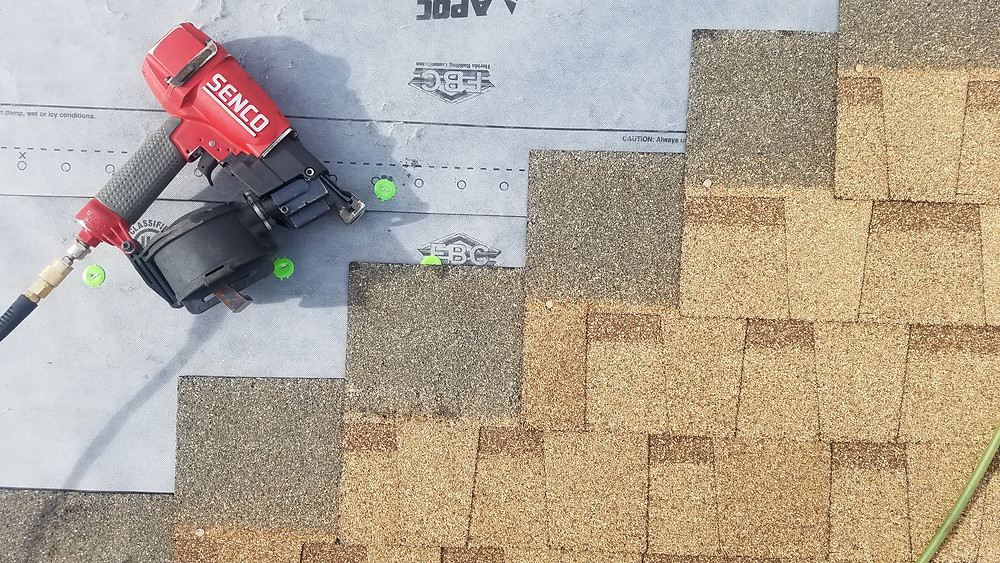Shingles being installed by Flat Rate Roofers over hybrid underlayment