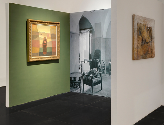 Installation view (Left to right): Sliman Mansour, Girl in the Village, 1982, Oil on Canvas, 82 x 71 cm; Sliman Mansour The Village, 1990, Mud on Wood, 80 x 85 cm. © Tabari Art Space.