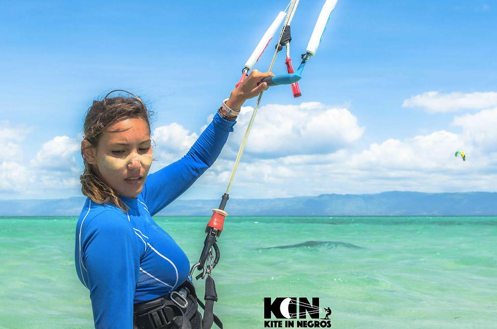 Kitesurf girl wearing sunblock on her face Kitesurf Philippines Kitesurf Dumaguete