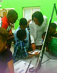 nadia.community.kids.at.table.close_edit
