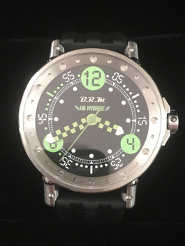 V6-44 HYB Case: Brushed stainless steel Diametre: 44 mm Lugs and crown: Finest 18/8 stainless steel Dial: Black with lime green V6 Hybride transfers Hands: Black and lime green chequered super light Strap: Black rubber Sapphire upper crystal and engraved back Specific screws in finest stainless steel Water-resistance: 100m Three-year warranty  Hybride BTY75 movement An automatic rotor weight winds a micro-alternator which stores energy via a recuperator; this energy powers quartz motor. The movement has six jewels to allow the rotor axes to turn properly. After a full charge the lifespan is around six months. From $3,100.00