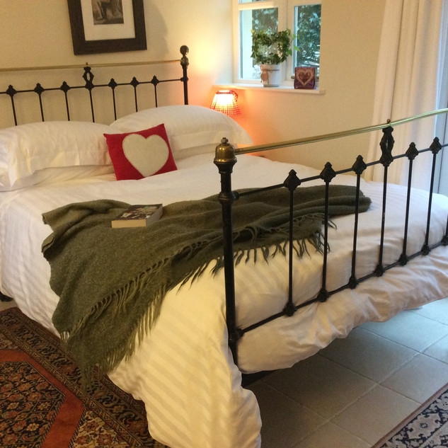 Cosy Victorian Iron bed with crisp cotto