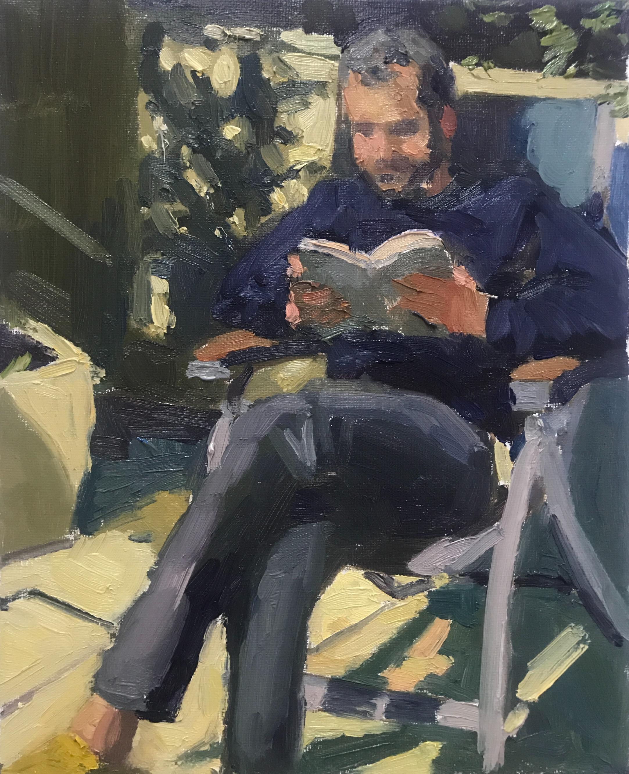 Ali reading in the backyard