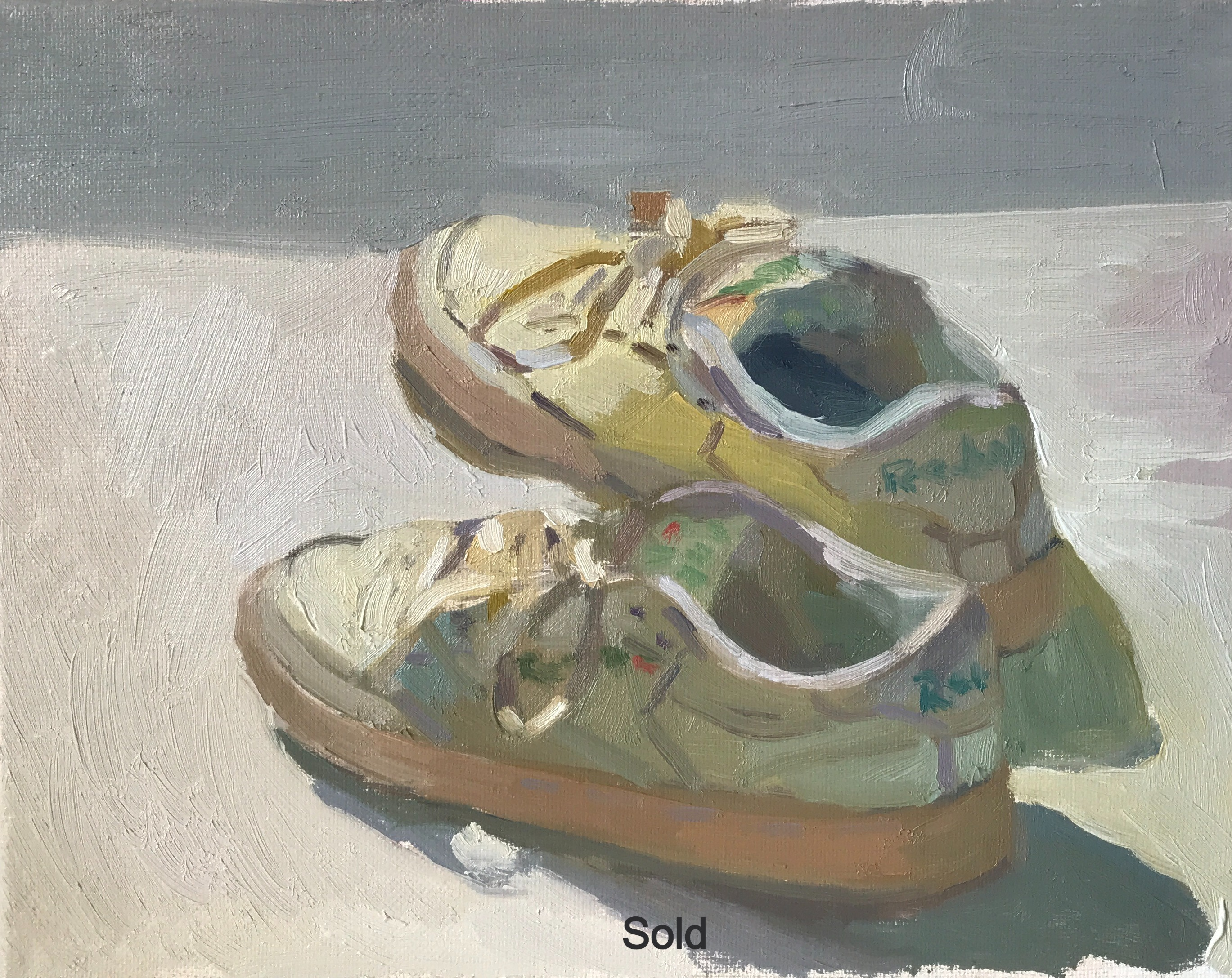 White pair of reebok shoes