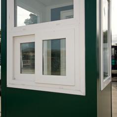 Kiosk sliding toll window