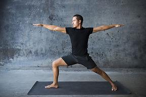 bigstock-Man-practicing-yoga-against-a--