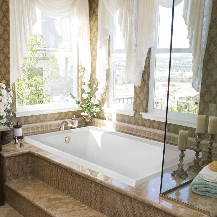 A beautiful bathroom tub and view