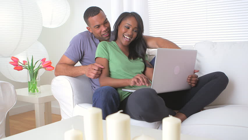 Couple sitting together looking at computer