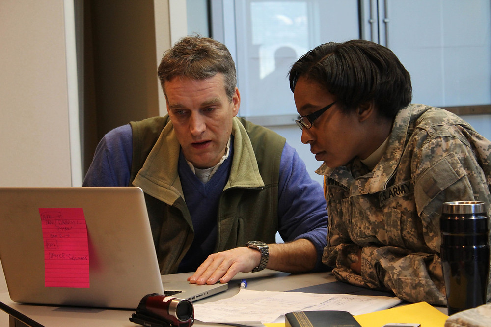 Benjamin Patton teaching editing to Veteran student