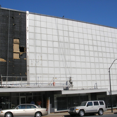 As aluminum panels were removed, the underlying 1920's structure began to emerge