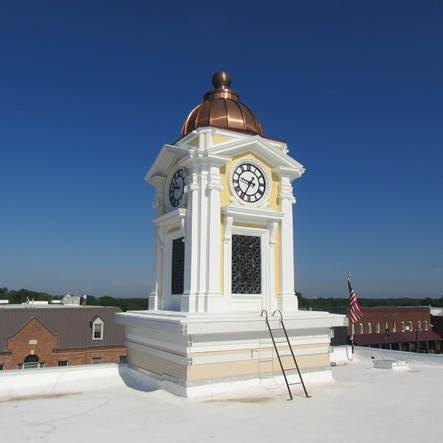Completed clock tower included new copper dome. Terra-cotta and brick masonry mortar joints were tuckpointed and coated using Loxon XP. Inside; the exisiting concrete floor was removed, replaced, and deck coating applied. All interior walls were tuckpointed.