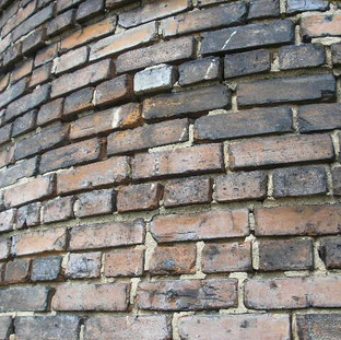 Existing conditions at the top of the chimney where the brick masonry mortar joints were tuckpointed 100%.