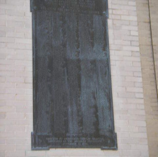 Original bronze plaques were located at several locations on the front elevations.