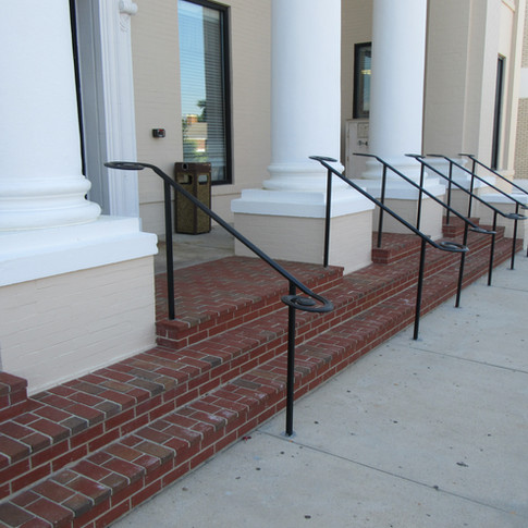 Columns and column bases were repaired and coated using Loxon XP coating. Additional handrails were installed across the entire front entry.