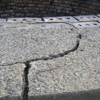 Cracks in concrete cap were injected with epoxy.