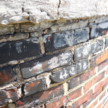 """Deteriorated brick masonry mortar joints were cut back 3/4"""" and solidly tuckpointed at the top 60' of the chimney"""