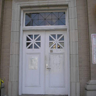 The same deteriorated conditions occurred at all exterior doors, throughout the building exterior. Wood doors were the original 1912 construction.