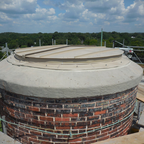 Finished top included new aluminum cap, repaired cracks, cementitious coating on the concrete cap, and mortar joints tuckpointed