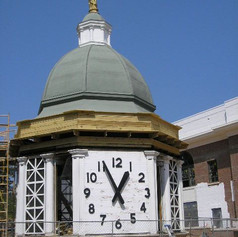 Cupola was removed from the Courthouse roof and placed in adjacent parking lot.