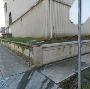 Deteriorated concrete retaining walls encompassed the courthouse complex.