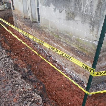 Below grade walls were excavated and cleaned