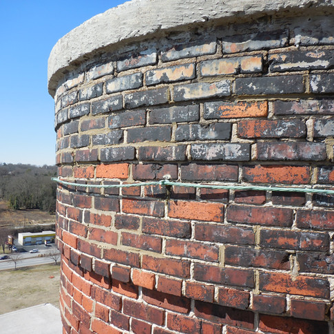Brick masonry mortar joints at the top 60' of the chimney were severely eroded