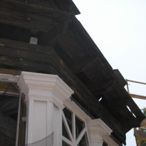 Metal coverings were removed to expose deteriorated wood.