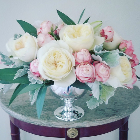 White and blush flowers in a silver compote vase