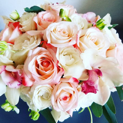Light coral pink and cream color bouquet