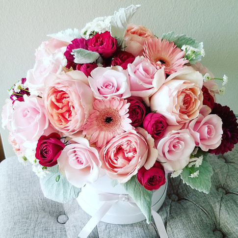 Gift flowers in a white hat box