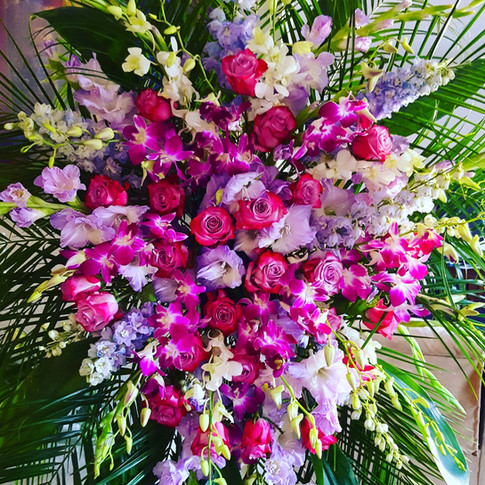 Gladiolus and orchids standing spray