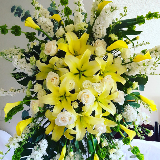 Yellow lilies and roses standing spray